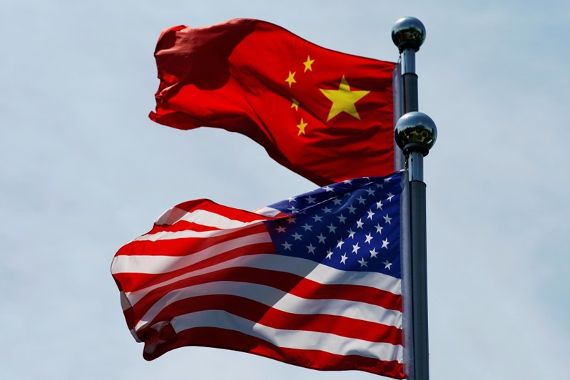 FILE PHOTO: FILE PHOTO: FILE PHOTO: Chinese and U.S. flags flutter near The Bund in Shanghai