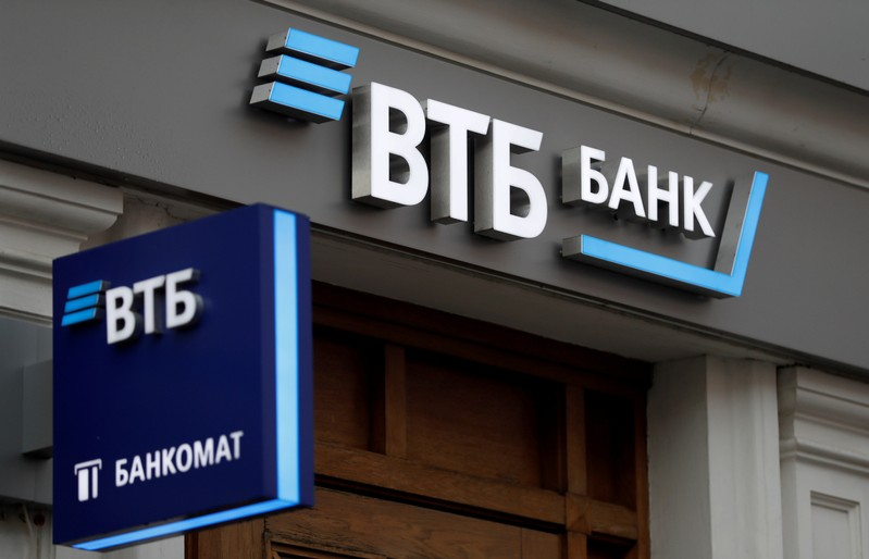 FILE PHOTO: Logos are on display outside a branch of VTB bank in Moscow