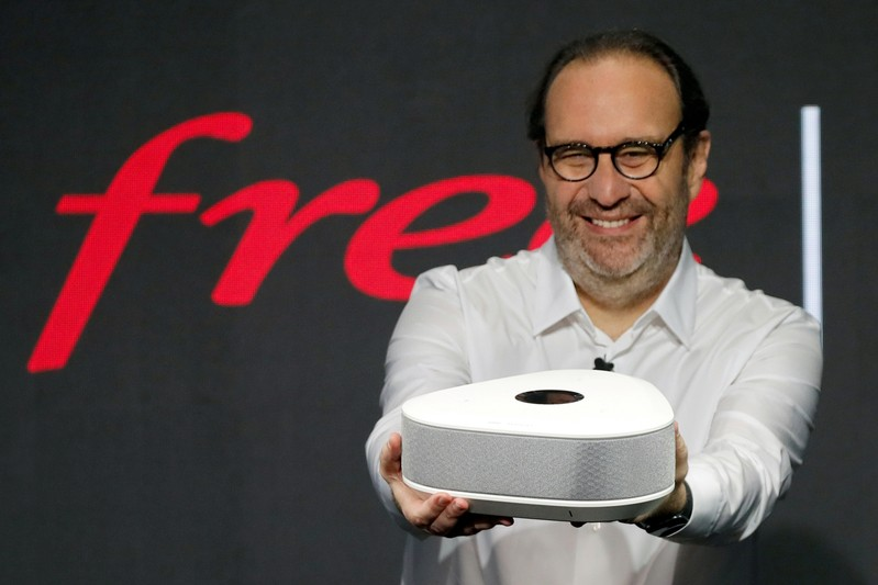 FILE PHOTO: Xavier Niel, founder of French broadband Internet provider Iliad, shows off the new set-top box, the Freebox Delta, in Paris