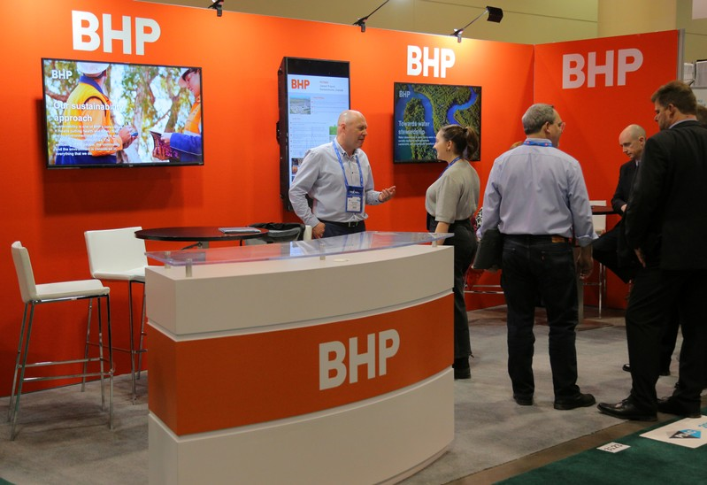 FILE PHOTO: Visitors to the BHP booth speak with representatives during the PDAC convention in Toronto
