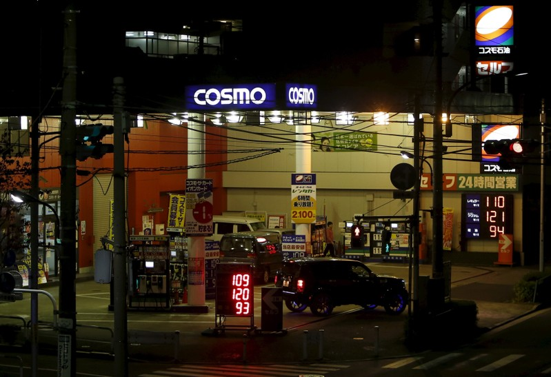 A car moves out from a Cosmo Energy Holdings' Cosmo Oil service station in Tokyo