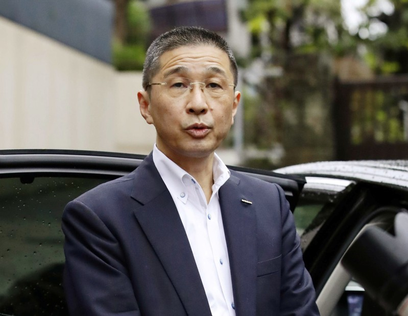 Nissan CEO Hiroto Saikawa speaks to media before the company's board members meeting in front of his residence in Tokyo
