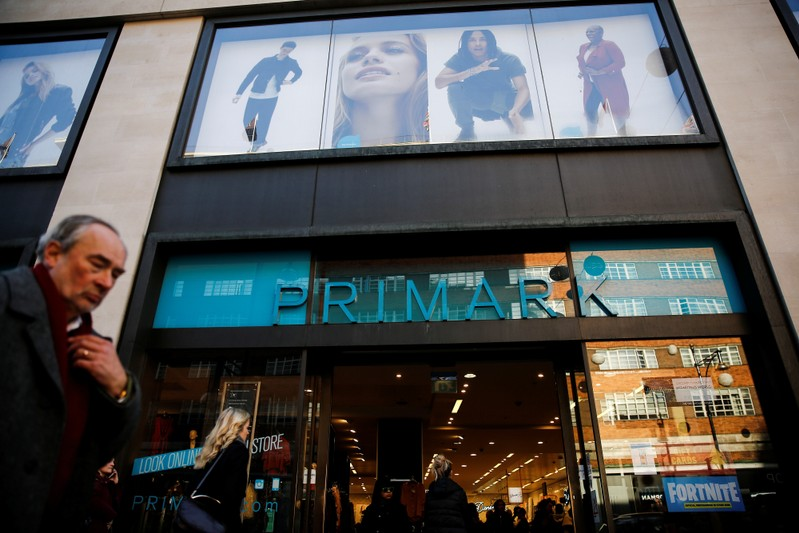 Shoppers walk past a Primark store on Oxford Street in London
