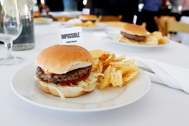 FILE PHOTO: The completed plant-based hamburger is displayed during a media tour of Impossible Foods labs and processing plant in Redwood City, California