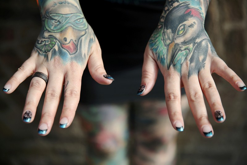 FILE PHOTO: A tattoo enthusiast poses at the International London Tattoo Convention in London