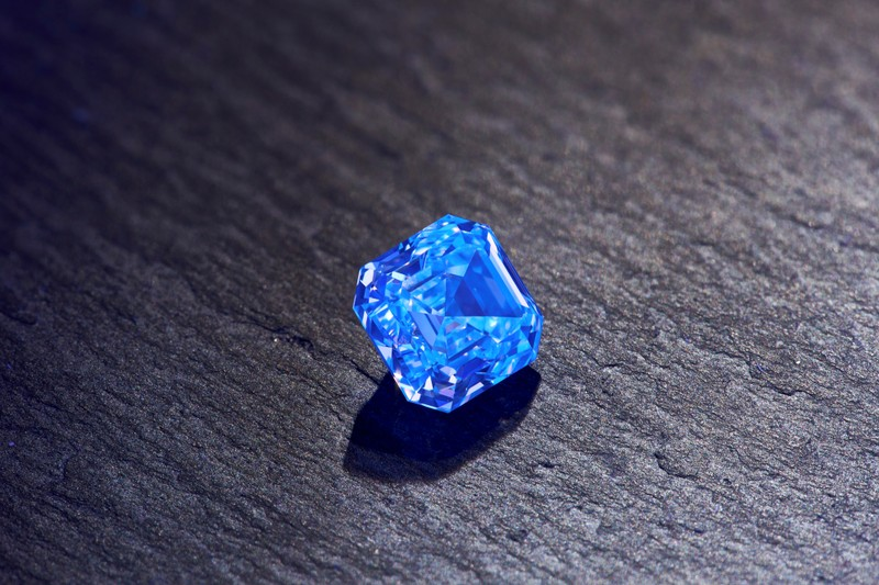 A view shows a fluorescent diamond manufactured by Alrosa company at an unknown location
