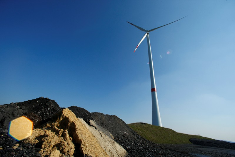 A wind turbine used to generate electricity is seen at the Brinkfortsheide dump near the Ruhr area city of Marl