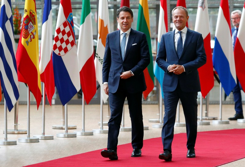 Italian PM Conte walks with EU Council President Tusk in Brussels