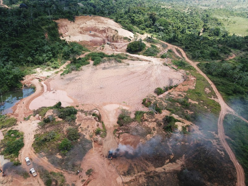 An aerial view shows machines being destroyed during an operation conducted by the Brazilian Institute for the Environment and Renewable Natural Resources (IBAMA) and Federal Police at an illegal gold mine near the city of Altamira