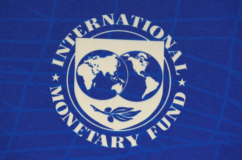 FILE PHOTO: The logo of the International Monetary Fund (IMF), is seen during a news conference in Santiago