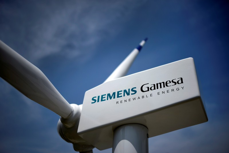 A model of a wind turbine with the Siemens Gamesa logo is displayed outside the annual general shareholders meeting in Zamudio