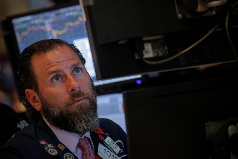 A trader works at his post on the floor at the NYSE in New York