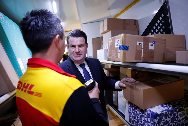 German Labour Minister Hubertus Heil talks to a truck driver of German postal and logistics group Deutsche Post DHL during his visit to a parcels distribution centre in Berlin