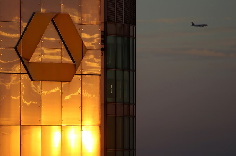 The logo of Germany's Commerzbank is seen in the late evening sun on top of its headquarters in Frankfurt