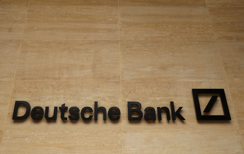The logo of Deutsche Bank is pictured on a company's office in London