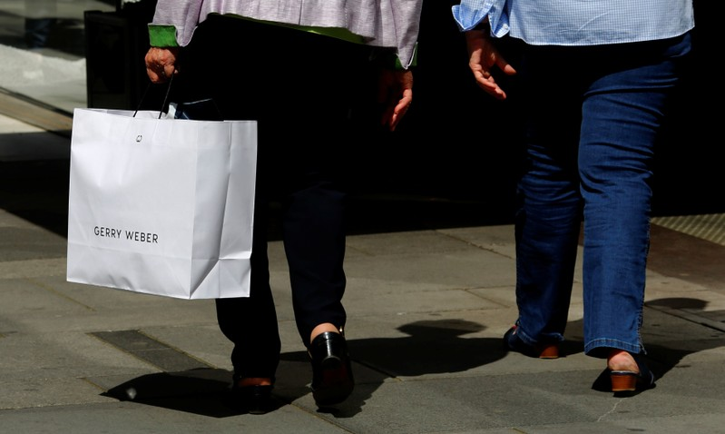 A women carries a shopping bag of German fashion brand Gerry Weber in Vienna