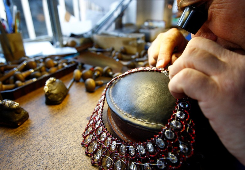 File photo of a  worker uses traditional handcrafting techniques at the Bucellati atelier downtown in Milan