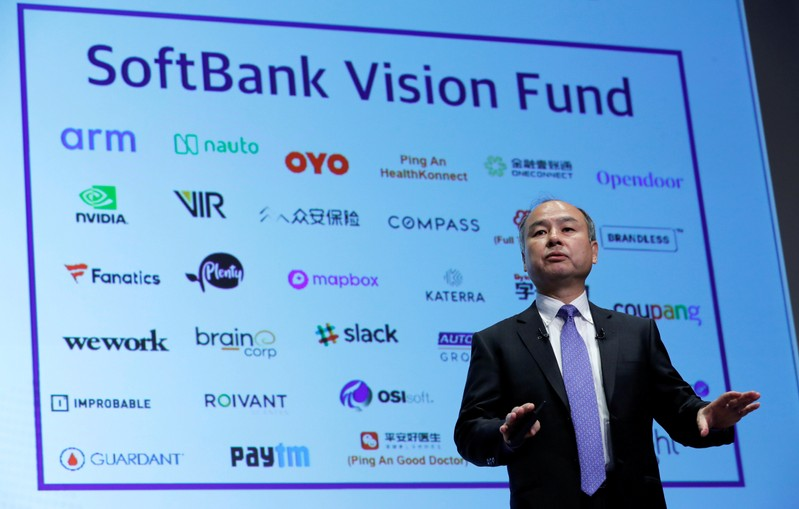 FILE PHOTO: Japan's SoftBank Group Corp Chief Executive Masayoshi Son attends a news conference in Tokyo