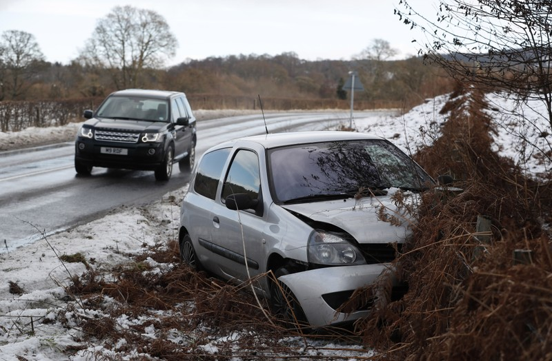 A damaged car lies off the A827 near Grandtully in Scotland