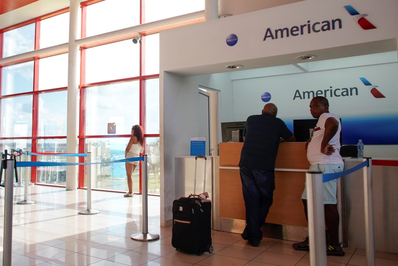 People stand at the American Airlines office at the Jose Marti International Airport in Havana