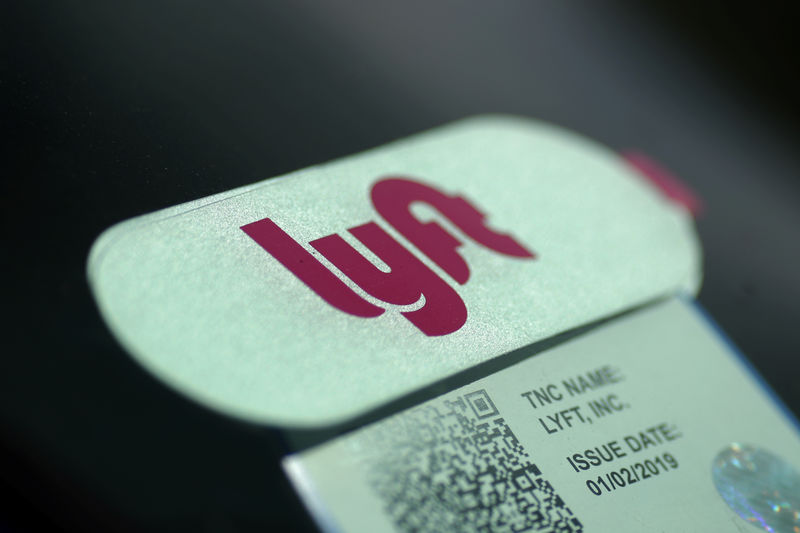 FILE PHOTO: A Lyft sticker is seen in a car windscreen in Los Angeles
