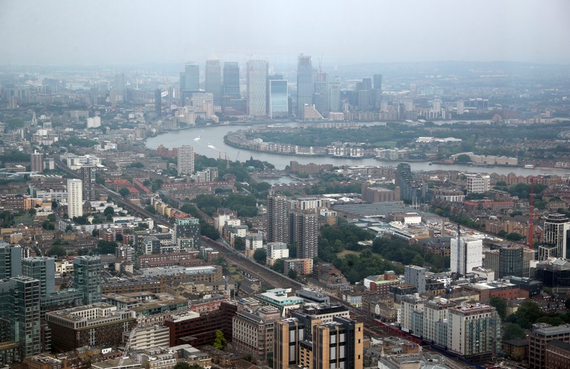 The Canary Wharf financial district is seen from the construction site of 22 Bishopsgate in London