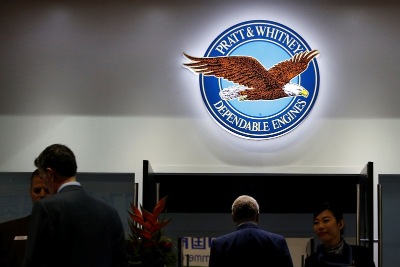 FILE PHOTO: The logo of U.S. manufacturer Pratt & Whitney is seen  as people visit the company's booth at the Singapore Airshow at Changi Exhibition Center