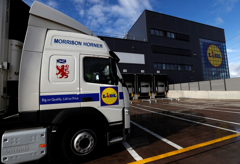 FILE PHOTO:  Lidl's logos are seen on its truck and the exterior of its new Scottish distribution centre as it commences operations in Motherwell, Scotland