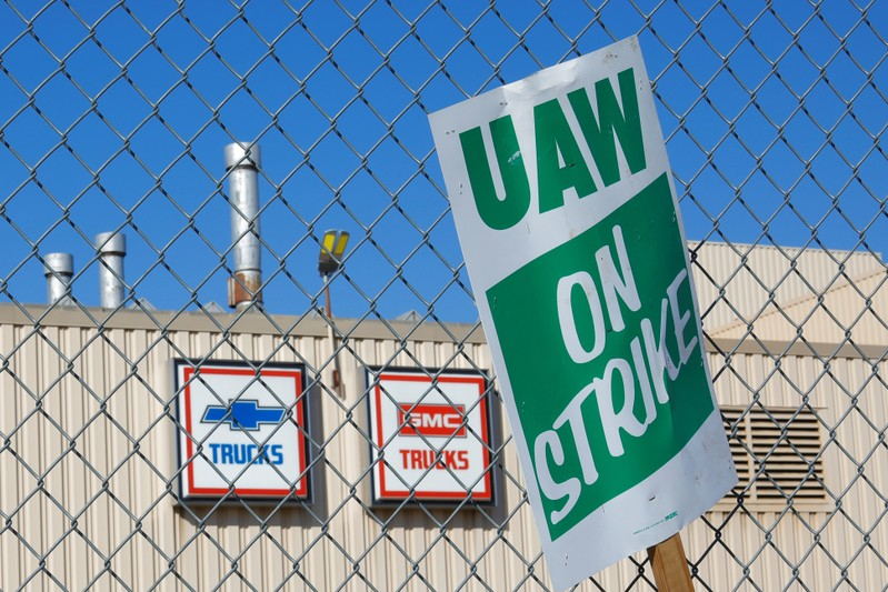 FILE PHOTO: A union strike sign is stuck in the fence outside the GM Flint Truck Assembly in Flint