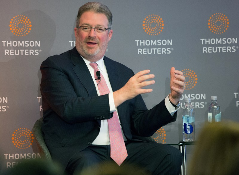 FILE PHOTO: Thomson Reuters Chief Executive Jim Smith speaks about the deal with Blackstone Group in Toronto
