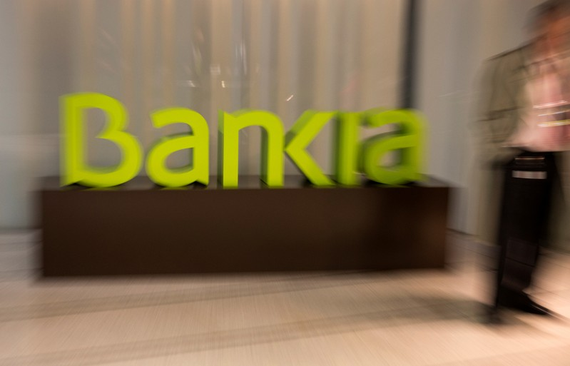 FILE PHOTO: Spain's Bankia logo is seen inside bank's headquarters before a news conference to present their annual results in Madrid