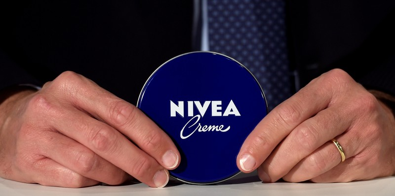 FILE PHOTO: Stefan Heidenreich, CEO of German personal-care company Beiersdorf, poses with a Nivea tin before the annual shareholders meeting in Hamburg