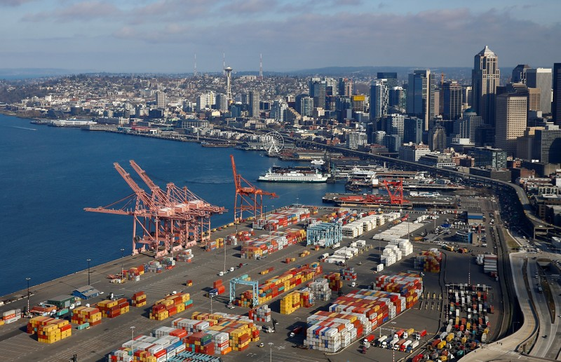 FILE PHOTO: An aerial photo looking north shows shipping containers at the Port of Seattle and the Elliott Bay waterfront in Seattle