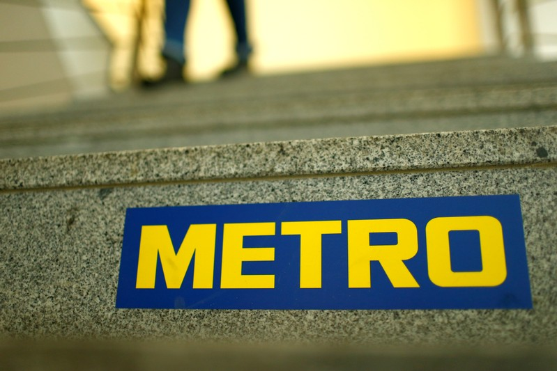 FILE PHOTO: German retailer Metro AG sign is seen on the steps of their headquarters in Duesseldorf