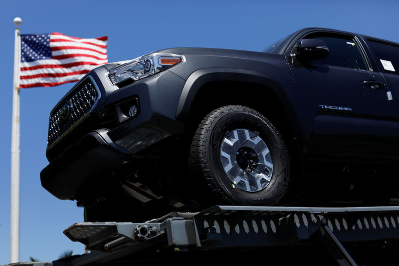 FILE PHOTO:  Toyota trucks are shown on a car carrier for delivery after arriving in the United States in National City, California
