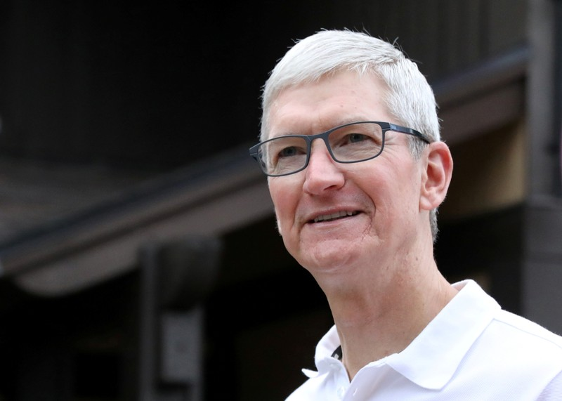 FILE PHOTO: Tim Cook, CEO of Apple, attends the annual Allen and Co. Sun Valley media conference in Sun Valley, Idaho