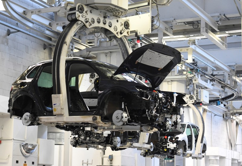 A car body is moved in a production line at the Volkswagen plant in Wolfsburg
