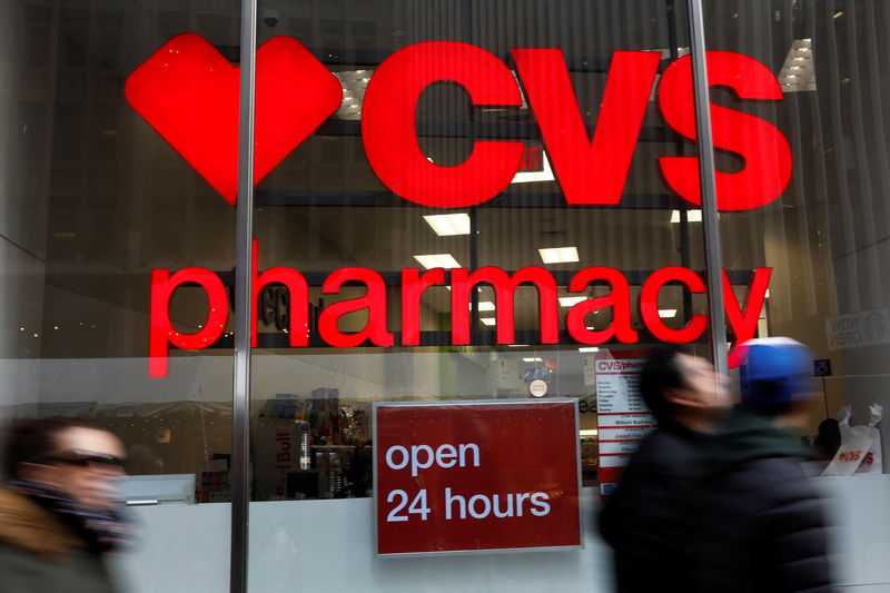 FILE PHOTO: People walk by a CVS Pharmacy store in the Manhattan borough of New York City