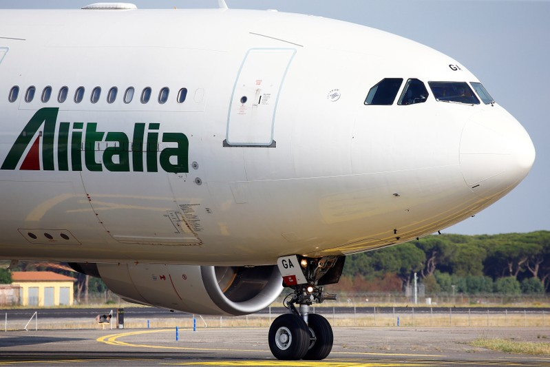 An Alitalia airplane is seen before take off from the Leonardo da Vinci-Fiumicino Airport in Rome