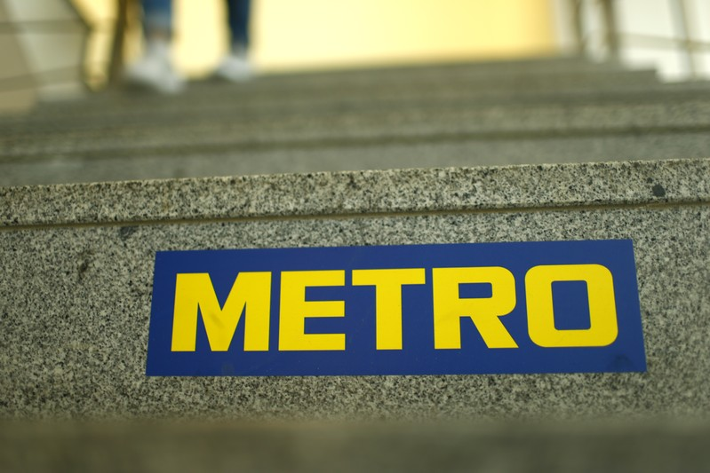 German retailer Metro AG sign is seen on the steps of their headquarters in Duesseldorf