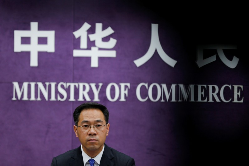 China's Ministry of Commerce spokesperson Gao Feng attends a news conference at the commerce ministry in Beijing