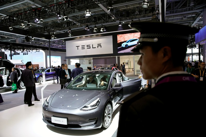A Tesla sign is seen at the second China International Import Expo (CIIE) in Shanghai