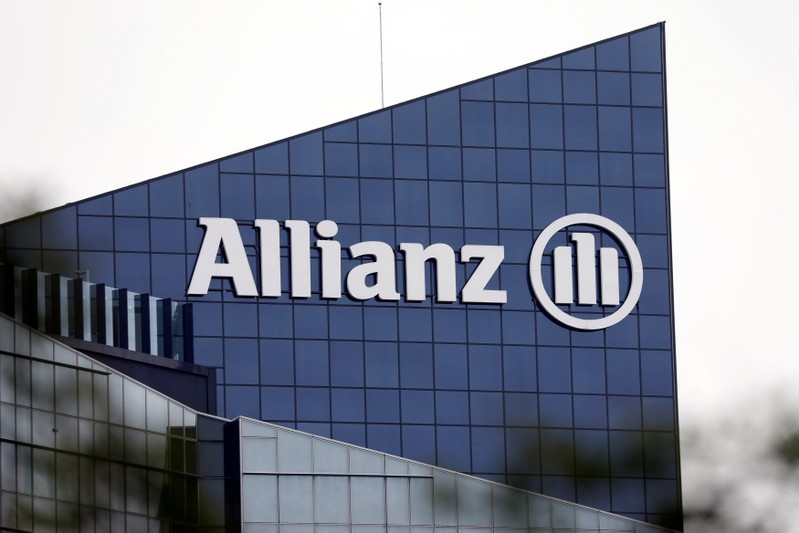 The logo of insurer Allianz SE is seen on the company building in Puteaux at the financial and business district of La Defense near Paris
