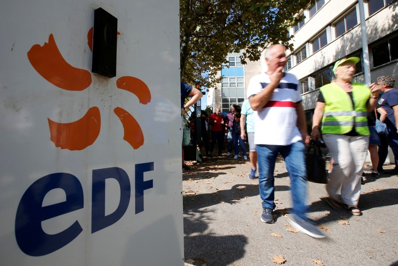 FILE PHOTO: Employees of France's EDF energy company attend a demonstration against the announced