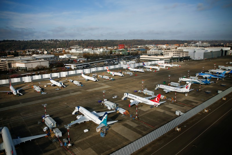 An aerial photo shows Boeing airplanes, many of which are grounded 737 MAX aircraft, at Boeing Field in Seattle