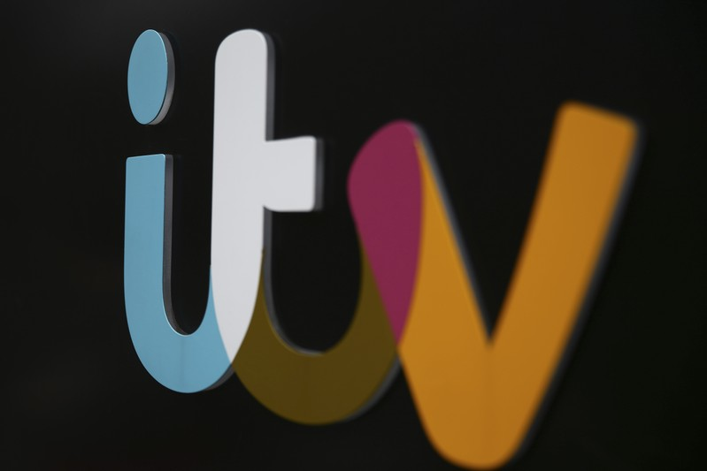 FILE PHOTO: A company sign is displayed outside an ITV studio in London