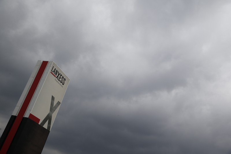 A logo of Lanxess is seen next to dark clouds at Cologne Bonn airport