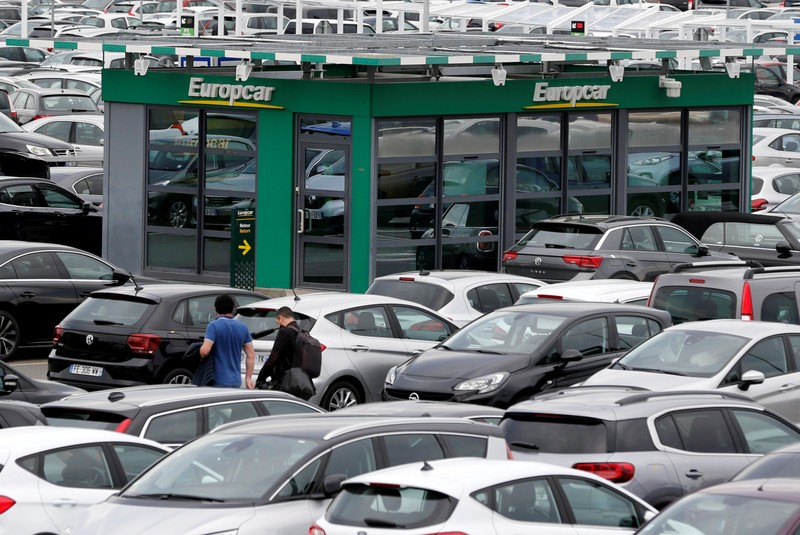 FILE PHOTO: Logos of car rental company Europcar are seen at the company's desk at the Bordeaux-Merignac airport, in Merignac