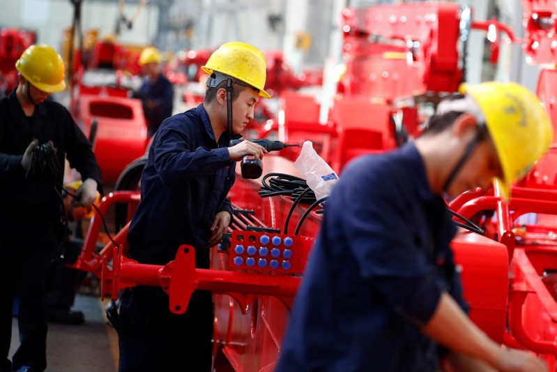 Employees work at a manufacturing plant of Sany Heavy Industry Co. in Changsha