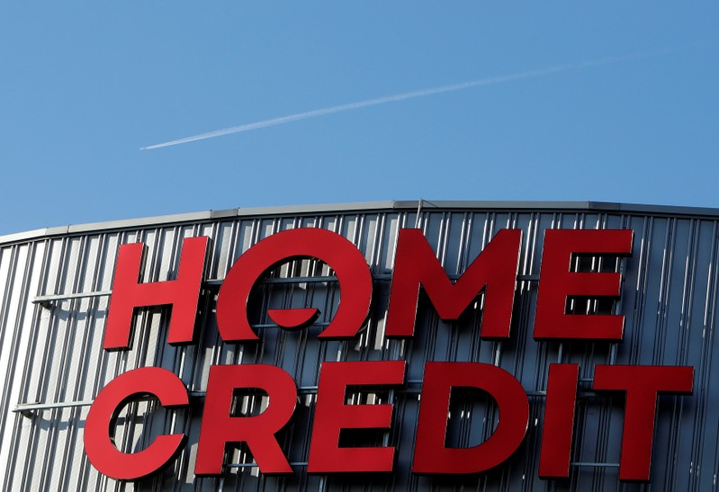 FILE PHOTO: An airplane flies over the logo of Czech consumer finance company Home Credit in Liberec